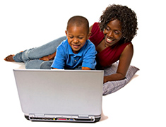 child and mother in front of a computer