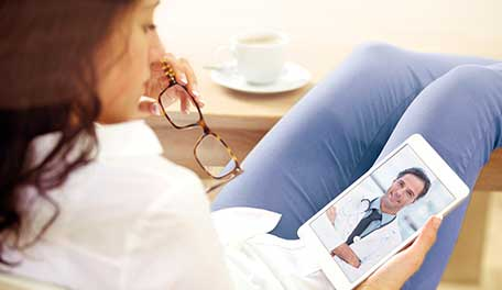 woman visiting doctor via tablet